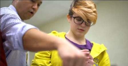 A teacher instructing a student
